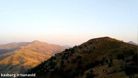 بانه - پشت کوه دوزین نمایی از روستای رشه قلات و سد رشه قلات